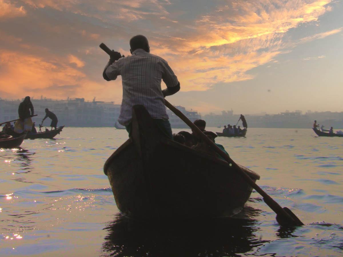 North East India - brahmaputra-boatman